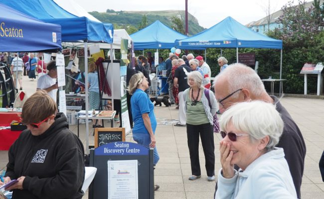 Image of Stalls and visitors of Natural Seaton Festival
