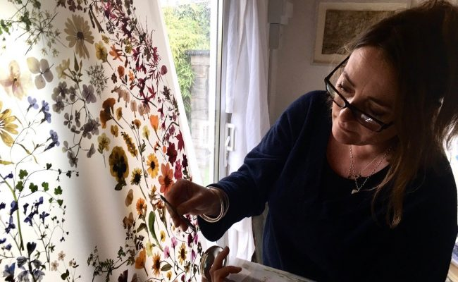 Artist with a pressed flowers display