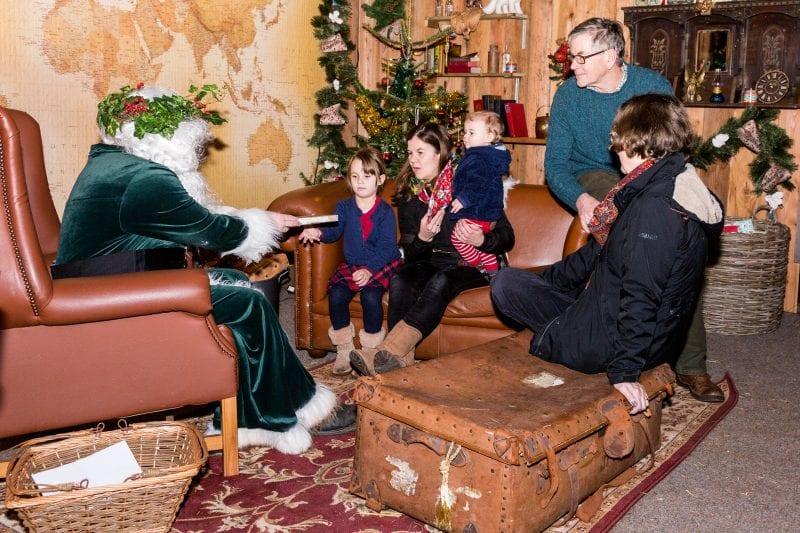 Children visiting Father Christmas at Killerton