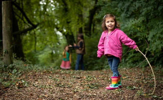 Child enjoys exploring the woods at The Donkey Sanctuary